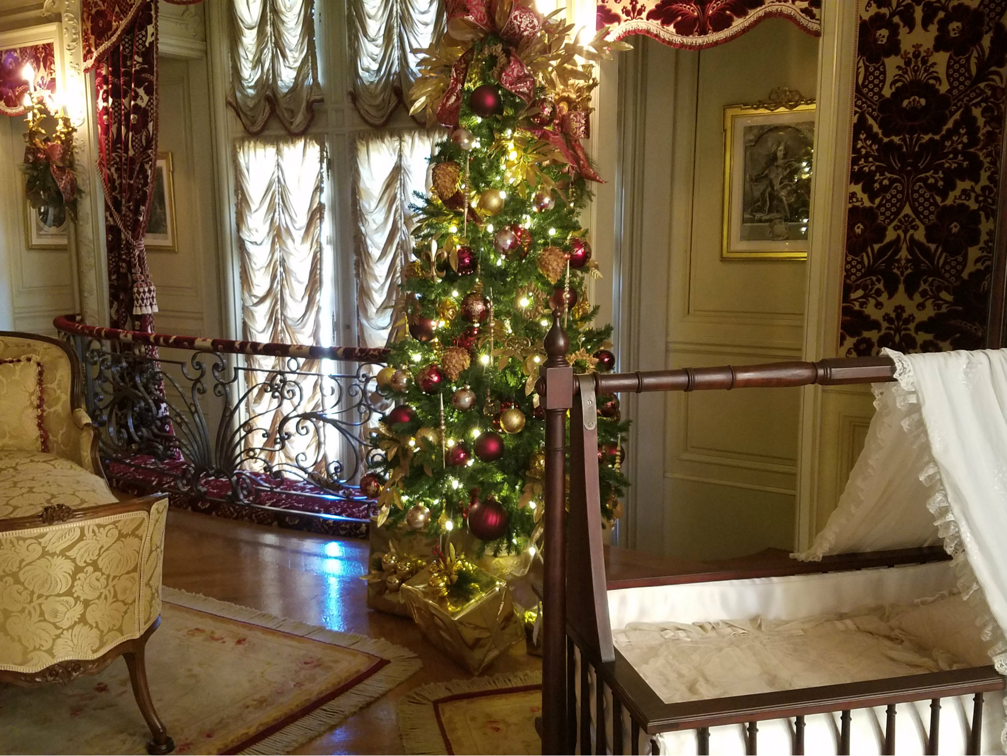 French chateau style bedroom with bassinet and Christmas tree