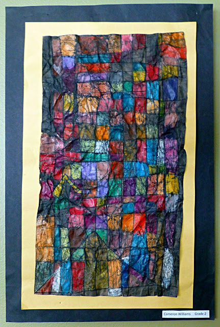 Abstract artwork with multi-colored squares and dark lines