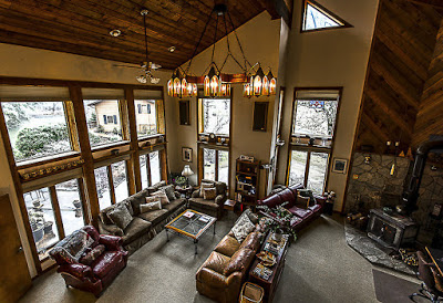 Large room with several couches and floor to ceiling windows