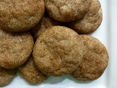 Plate full of sugar cookies that have been rolled in cinnamon before baking