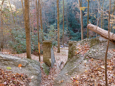 Mica mine ruins in the woods in autumn