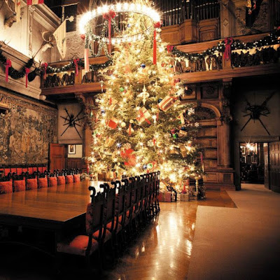 Very tall Christmas tree in a mansion's seven-story dining room