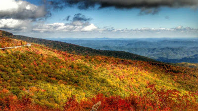Mountain vista with vibrant fall color on some ridges and subtle green on others