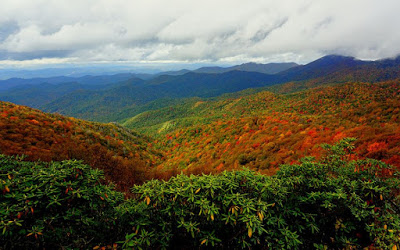 Mountain vistas with varying shades of blue, green, orange, red and yellow